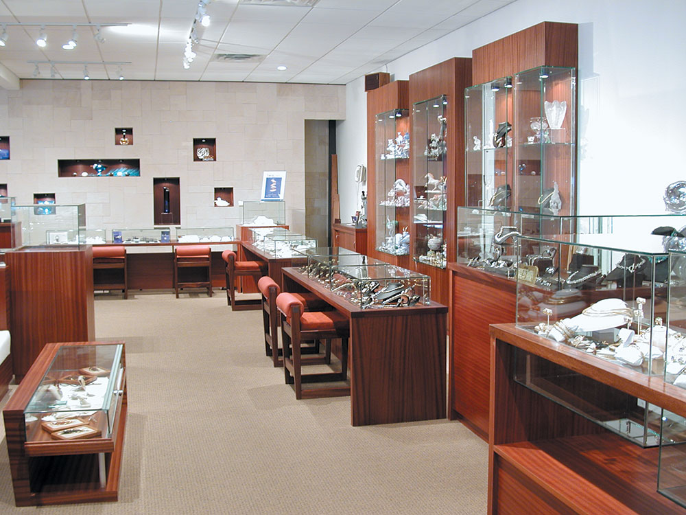 Store interiors and fixtures with elegant wood and glass custom furnishings