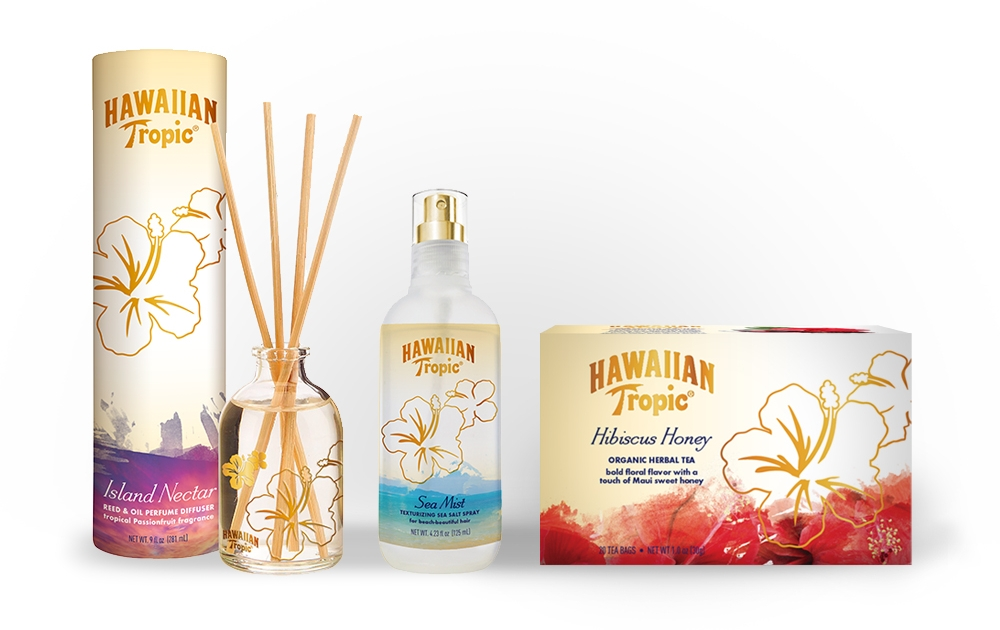 Product packaging incorporates the Hawaiian Tropic signature hibiscus, watercolor colorations and gold metallic accents.